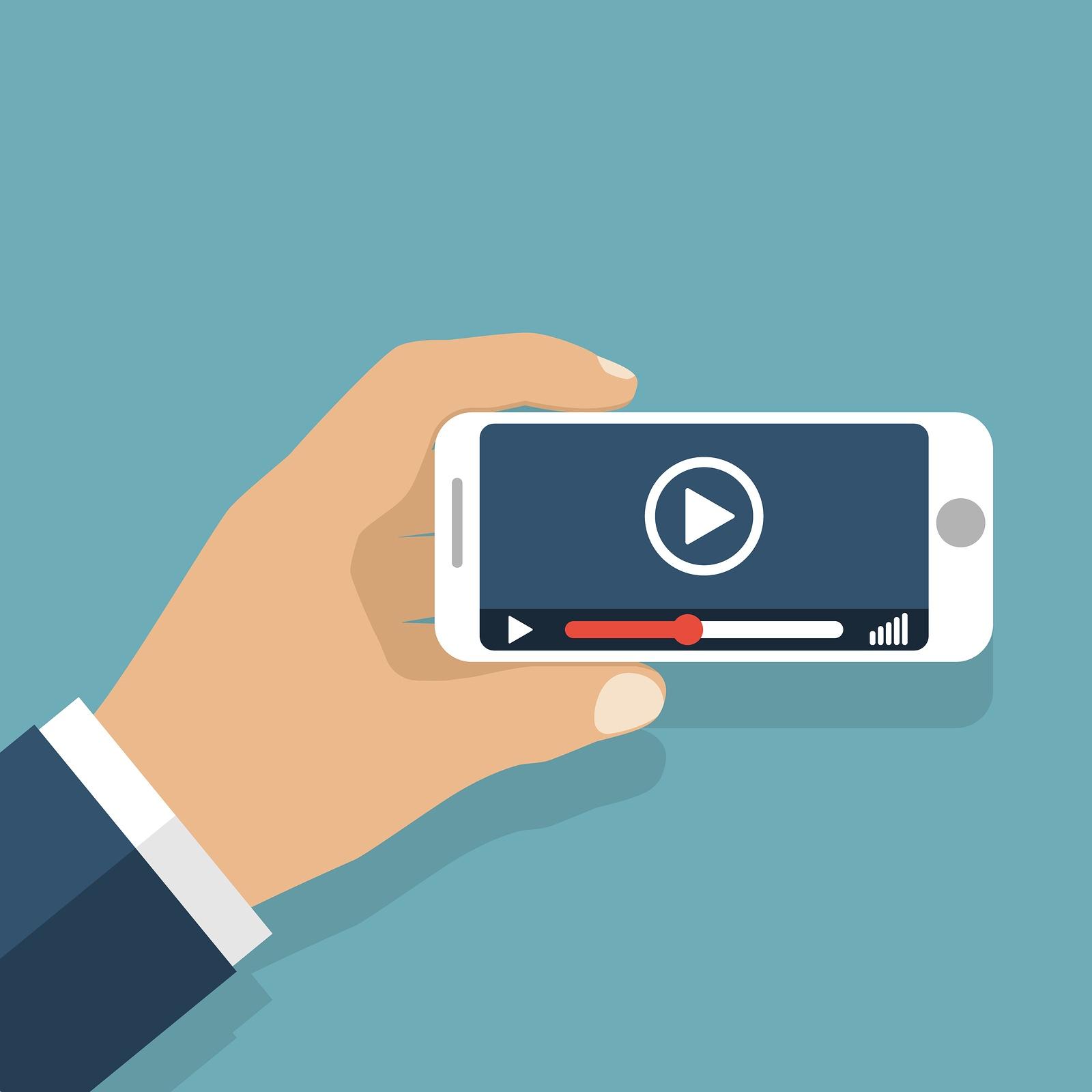 bigstock-Hand-Holds-Smartphone-Video-P-120737783.jpg