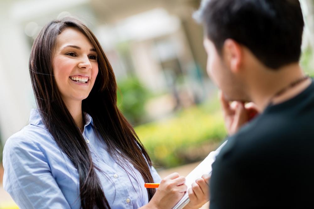 Happy woman on the street making a survey.jpeg